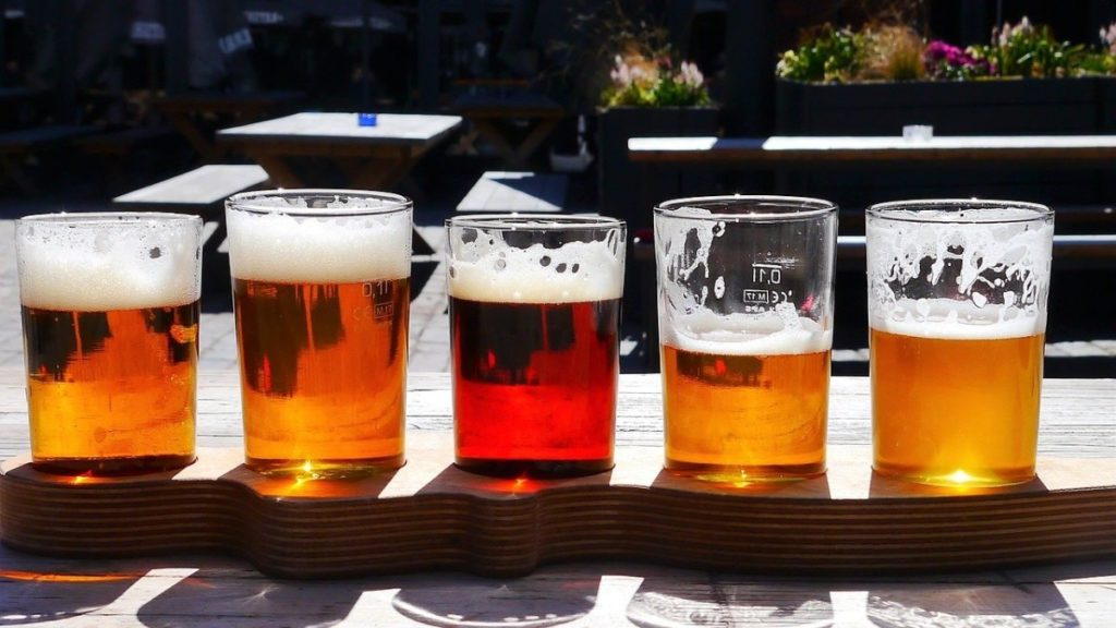 Flight of beers on wooden rack
