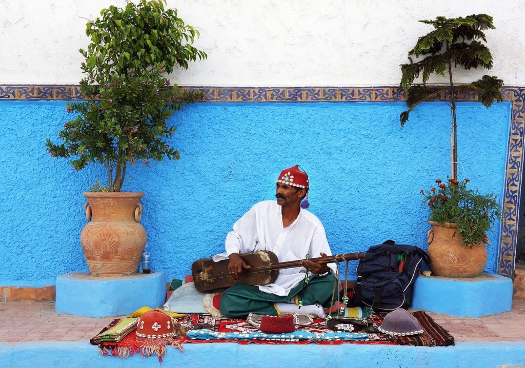 Street musician in Morocco playing live music