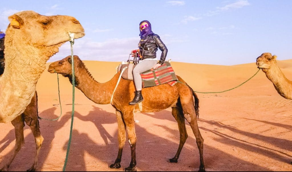 Eden Fite on a camel in the Sahara desert, Morocco