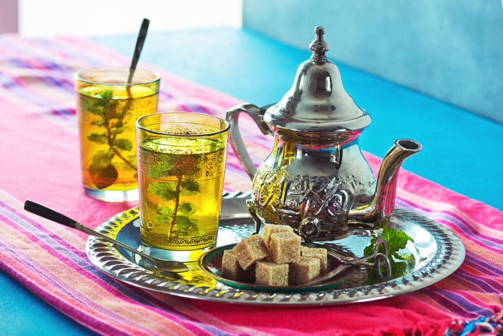 Tray of Moroccan mint tea on a blue table