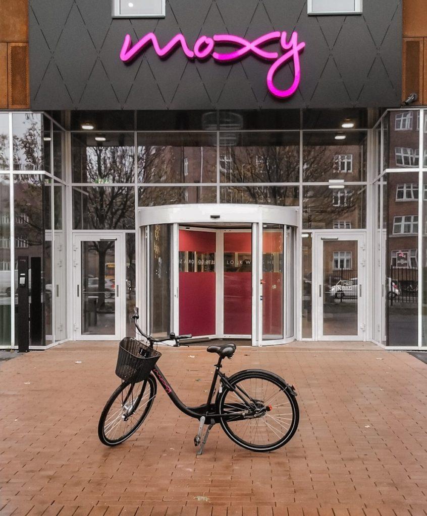 Black bicycle in front of the Moxy Hotel in Copenhagen, Denmark