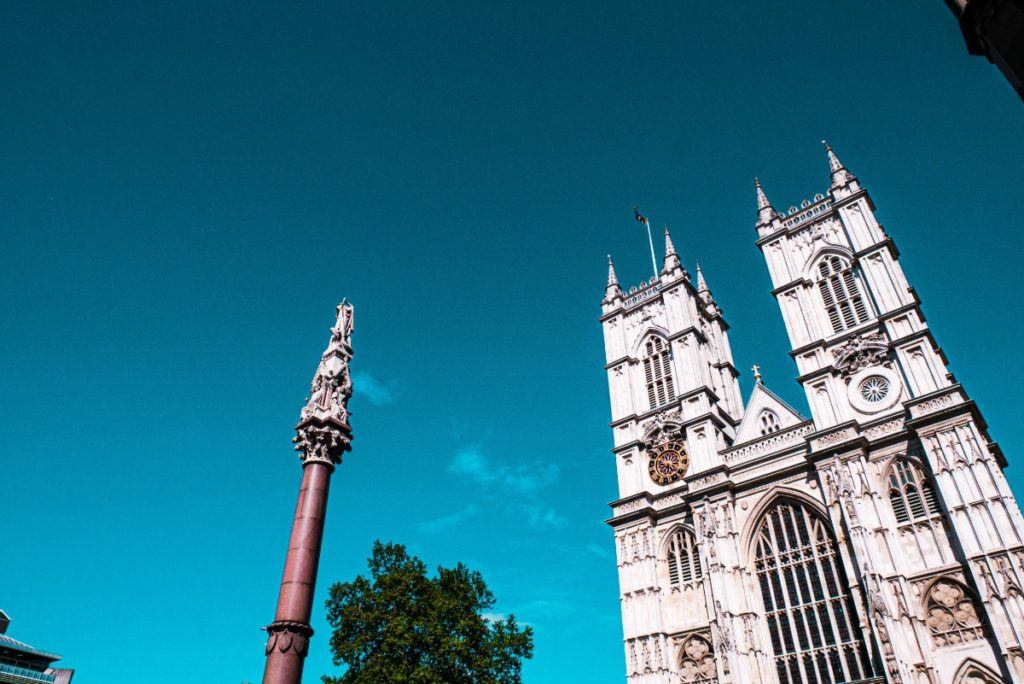 Looking up at Westminster Abbey in London with a deep blue sky in the background