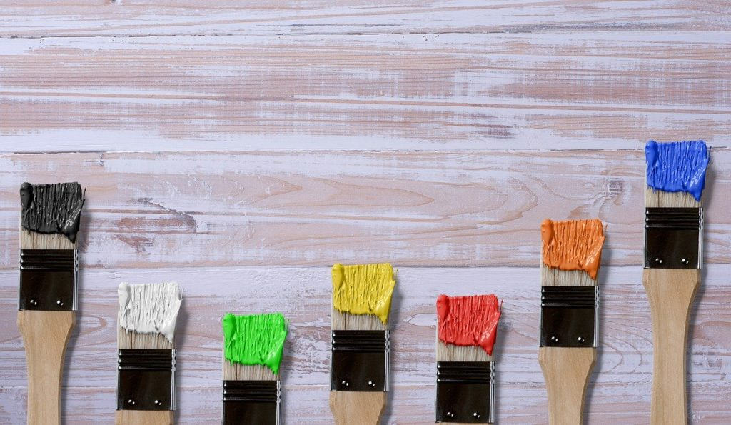paint brushes on wooden table