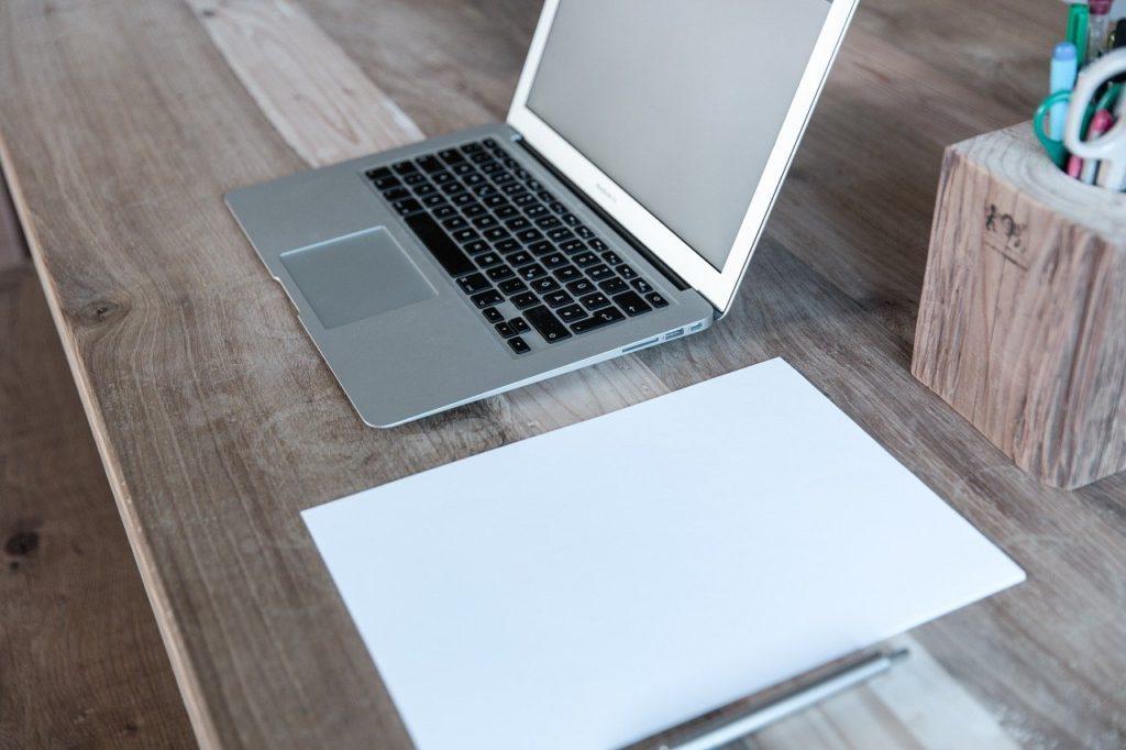 laptop on a desk for travel blogging